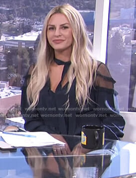 Morgan's navy tie neck blouse with mesh shoulders on E! News Daily Pop