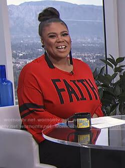 Nina's red faith sweater on E! News Daily Pop