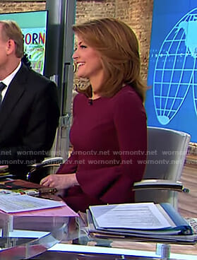 Norah's burgundy bell sleeve dress and fan earrings on CBS This Morning
