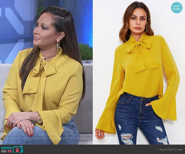 Bow Tied Neck Bell Cuff Curved Hem Blouse by Shein worn by Adrienne Houghton  on The Real