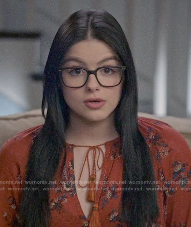 Alex's orange floral top on Modern Family