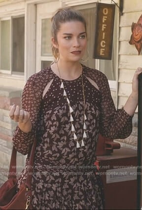 Alexis's brown mixed print dress on Schitt's Creek