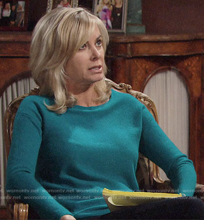 Ashley's teal green asymmetric hem sweater on The Young and the Restless