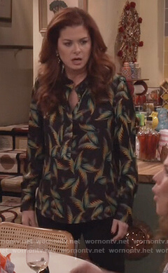 Grace's black palm leaf print blouse and chandelier earrings on Will and Grace