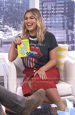 Carissa's black The Rolling Stones t-shirt and red skirt on E! News Daily Pop
