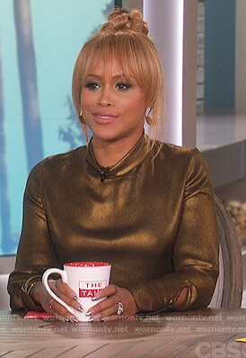 Eve's gold mock neck top on The Talk