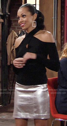Hilary's black cross-neck top and silver skirt on The Young and the Restless