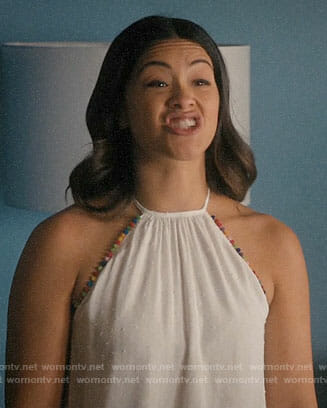 Jane's white top with rainbow pom pom trim on Jane the Virgin