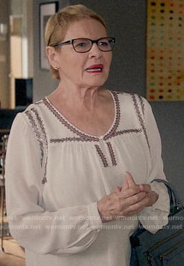 Joan's white embroidered blouse on Life in Pieces