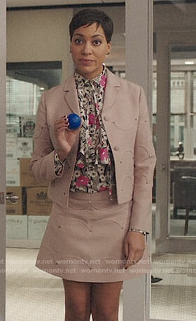 Lucca's pink studded skirt suit and floral blouse on The Good Fight