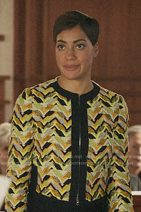Lucca's yellow chevron patterned jacket on The Good Fight