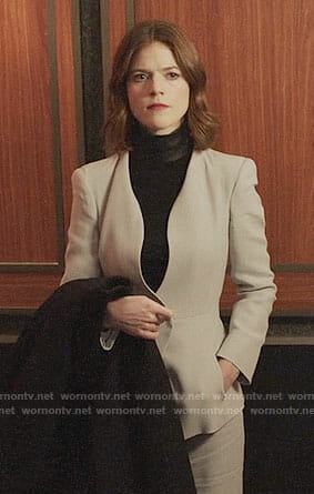 Maia's grey suit and black leather neck top on The Good Fight