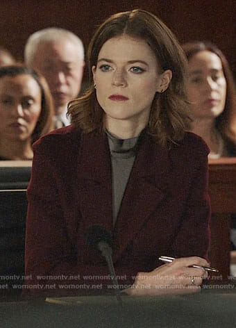 Maia's taupe mock neck blouse and burgundy coat on The Good Fight
