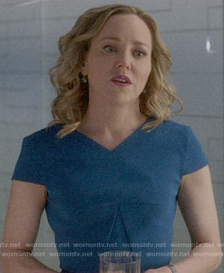 Marissa's blue v-neck dress on Bull