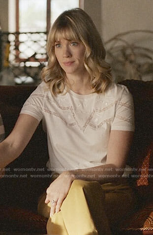 Melissa's white lace-inset top on Last Man on Earth