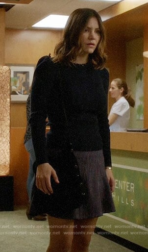 Paige's black puff-shoulder sweater on Scorpion