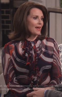 Karen's tie neck blouse and grommet pants on Will and Grace