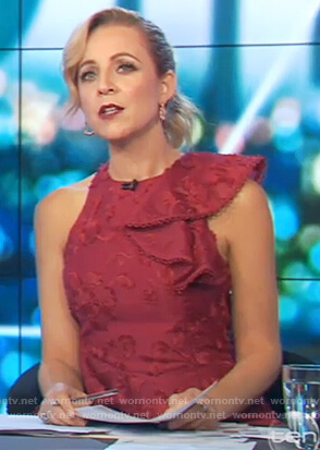 Carrie's red sleeveless ruffle dress on The Project
