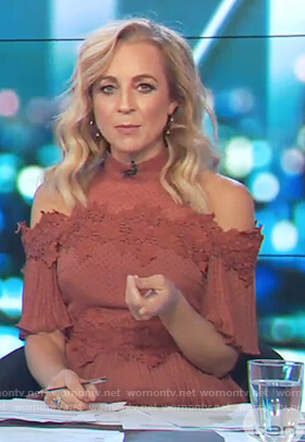 Carrie's red cold shoulder ruffle dress on The Project