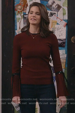 Leslie's red pleated sleeve sweater on Living Biblically