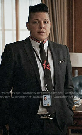 Kat's black and red star tie and shirt on Madam Secretary