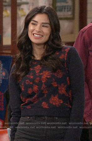Sofia's navy sweatshirt with floral front on Superior Donuts