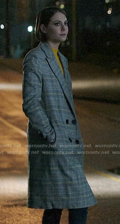Thea's yellow ribbed sweater and plaid coat on Arrow