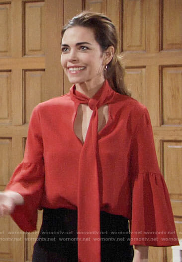 Victoria's orange tie neck blouse on The Young and the Restless