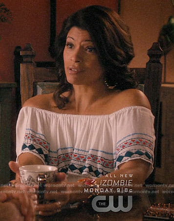 Xiomara's white embroidered off-shoulder top on Jane the Virgin