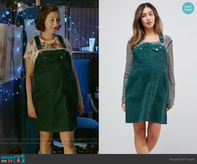ASOS DESIGN Maternity cord overall dress in emerald green worn by Carol Pilbasian (Kristen Schaal) on Last Man On Earth