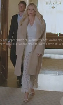Alexis's fur coat and white lace trousers on Dynasty