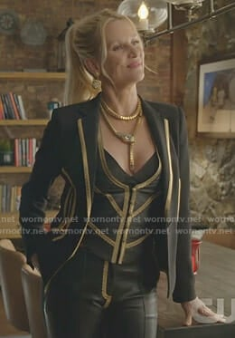 Alexis'w black jacket with gold trim and leather trousers on Dynasty