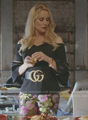 Alexis's black off-shoulder top with pearls and floral pants on Dynasty