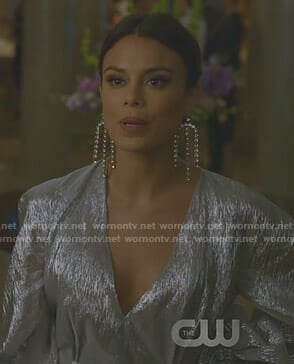 Cristal's metallic wrap dress and statement earrings on Dynasty
