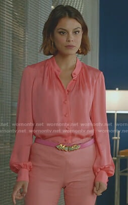Cristal's pink blouse and gold statement earrings on Dynasty