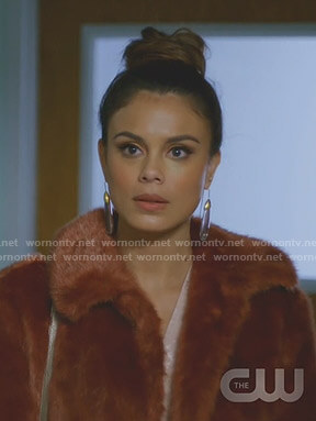 Cristal's pink jacquard blouse and brown fur coat on Dynasty