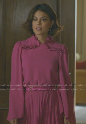 Cristal's pink ruffle blouse and pleated skirt on Dynasty