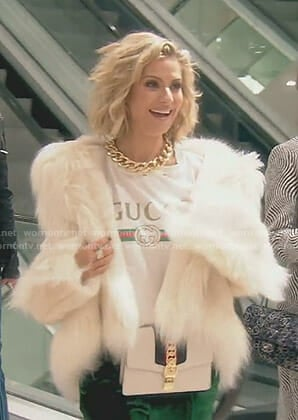 Dorit's white Gucci t-shirt and fur coat on The Real Housewives of Beverly Hills