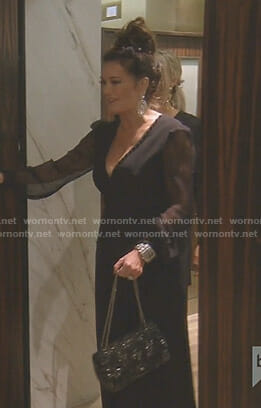 Lisa's black v-neck jumpsuit with sheer sleeves on The Real Housewives of Beverly Hills