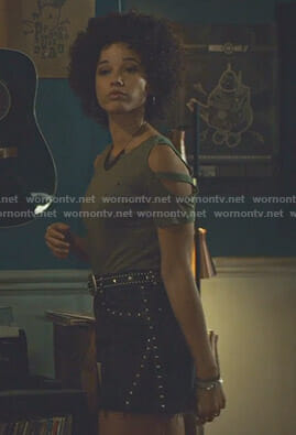 Maia's khaki cold-shoulder tee and studded mini skirt on Shadowhunters