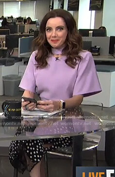 Melanie's purple cutout top and black polka dot skirt on Live from E!