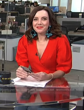 Melanie's red wrap blouse and turquoise beaded earrings on Live from E!