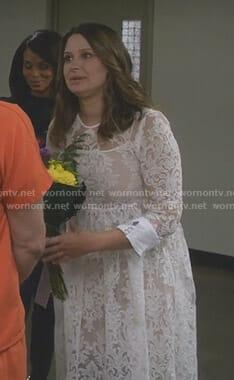Quinn's white long sleeve lace dress on Scandal