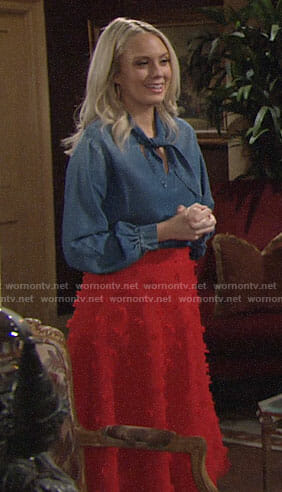 Abby's denim tie neck top and red textured skirt on The Young and the Restless