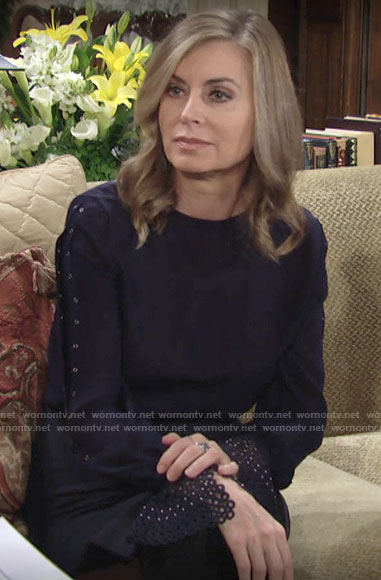 Ashley's navy blouse with eyelet cuffs on The Young and the Restless