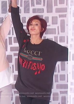 Sharon's black Gucci print sweater on The Talk