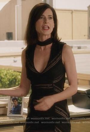 Nina's black sleeveless choker neck dress on Famous in Love