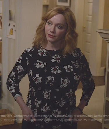 Beth's black floral print long sleeve top on Good Girls