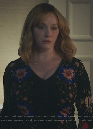 Beth's black v-neck floral print sweater on Good Girls