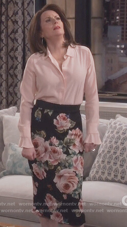 Karen's pink ruffle cuff blouse and rose print skirt on Will and Grace